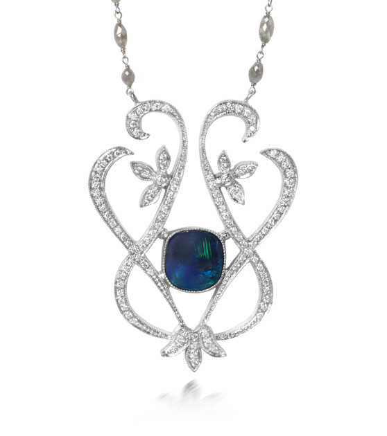 Just Jules black opal necklace surrounded by a rose-cut diamond enhancer
