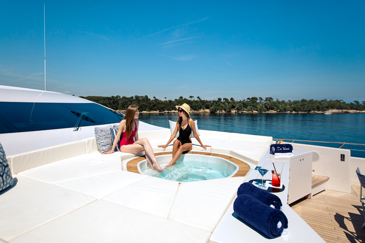 Two girls lounging on the foredeck of DA VINCI
