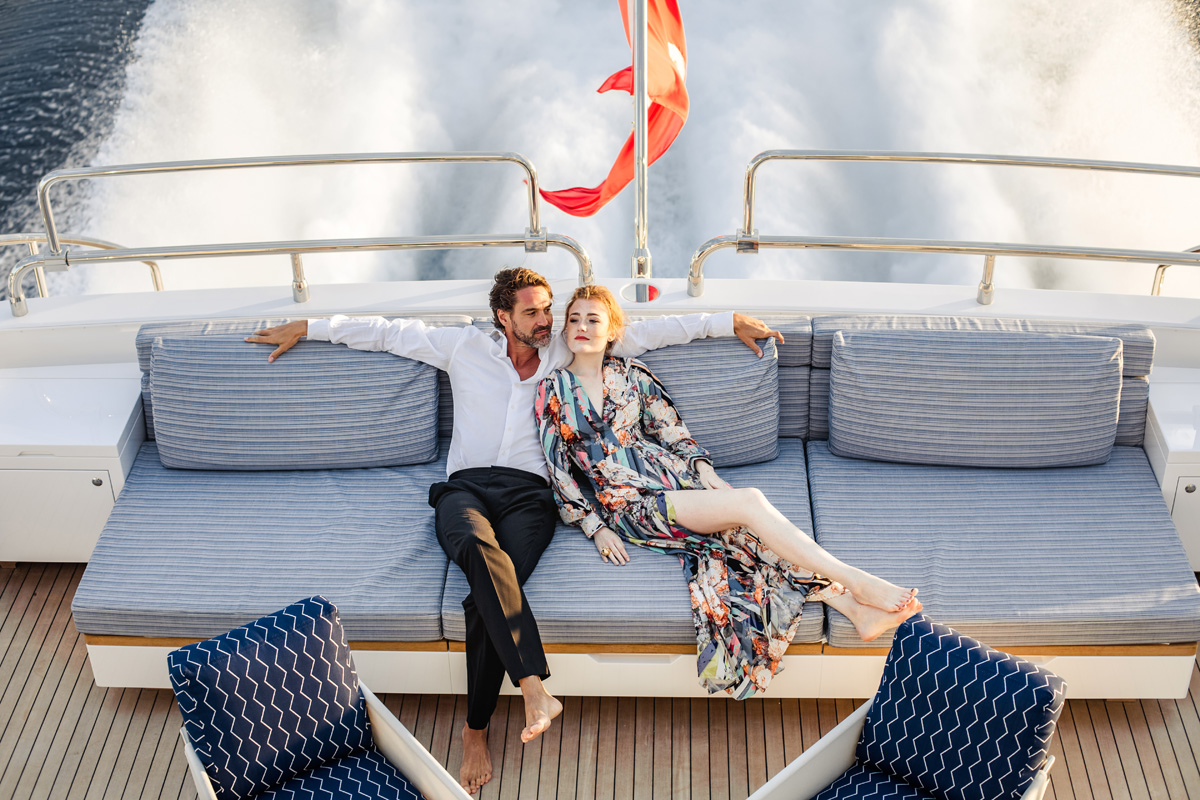 Couple lounging on the aft deck of DA VINCI