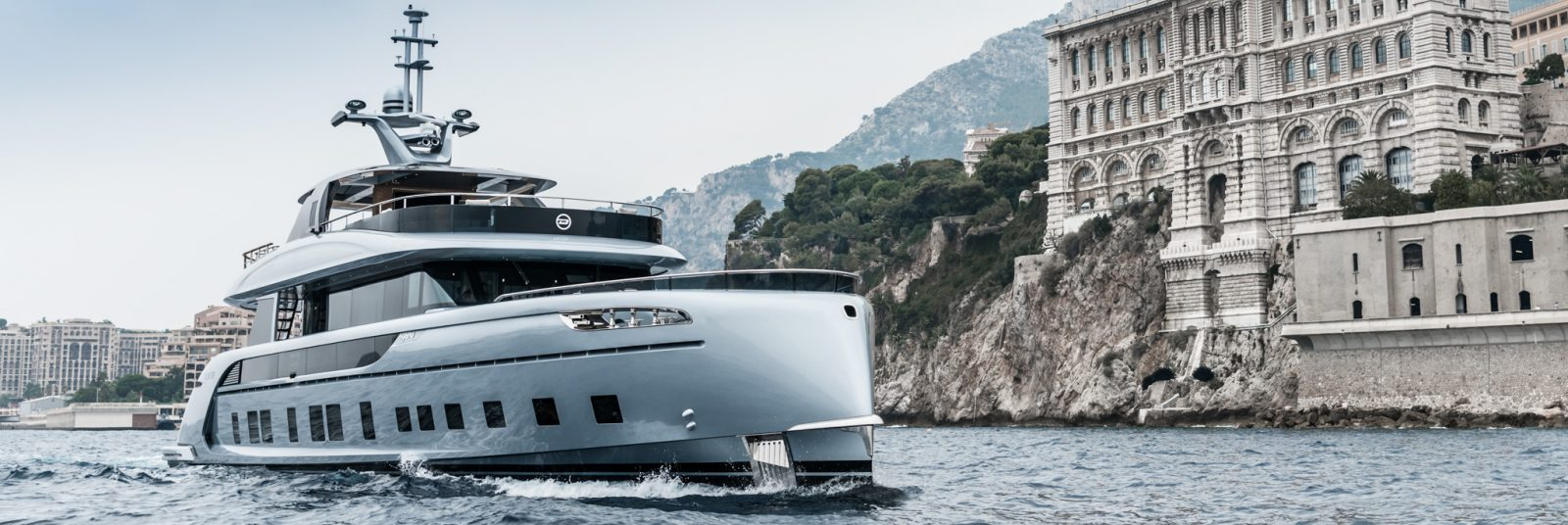 Modern superyacht for sale cruising off the coast of Monaco