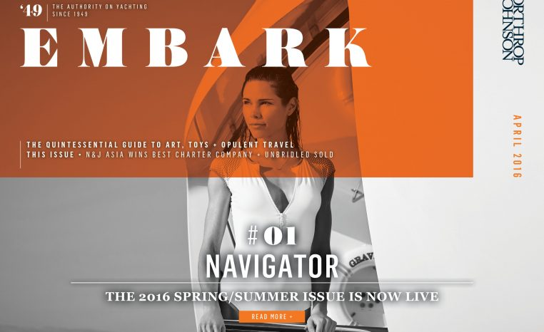 Main Embark image featuring a young woman leaning on the railing of a charter yacht