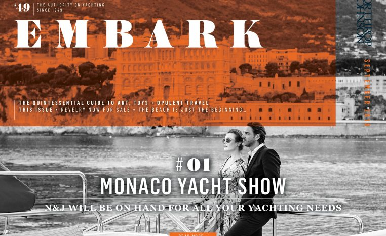 Main Embark image featuring a couple on board a superyacht while cruising off the coast of Monaco