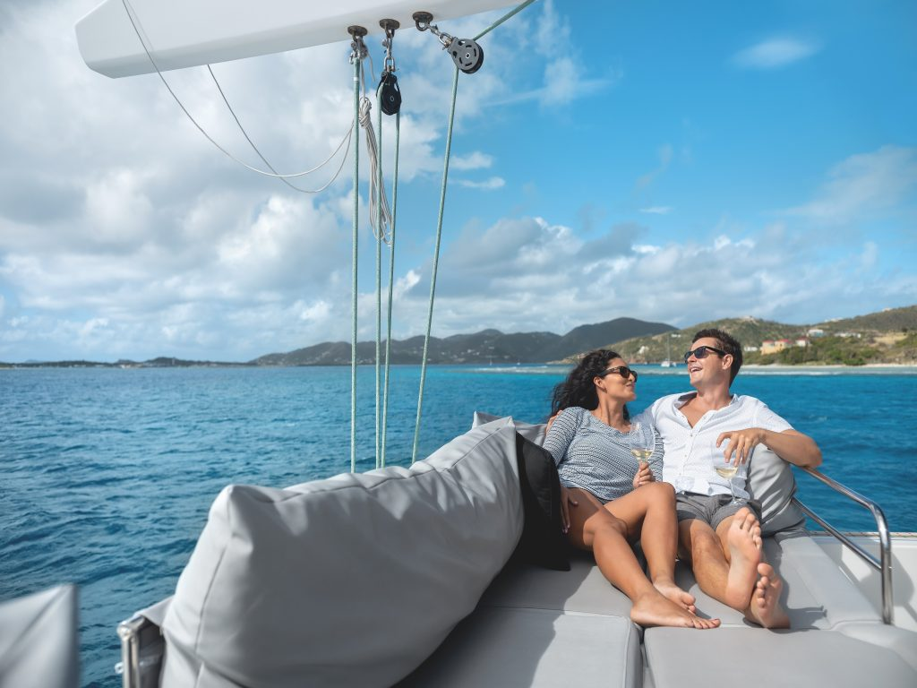 Couple lounging on a sailing yacht