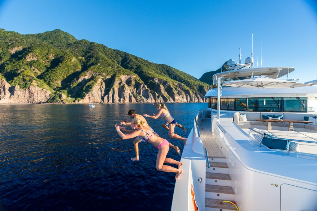 People jumping off a yacht