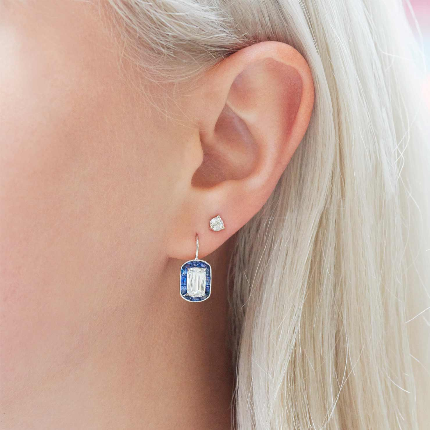 diamond earrings on French hooks with sapphire halo.