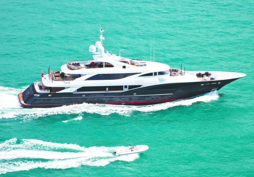Charter Yacht LIBERTY cruising with her RIB tender