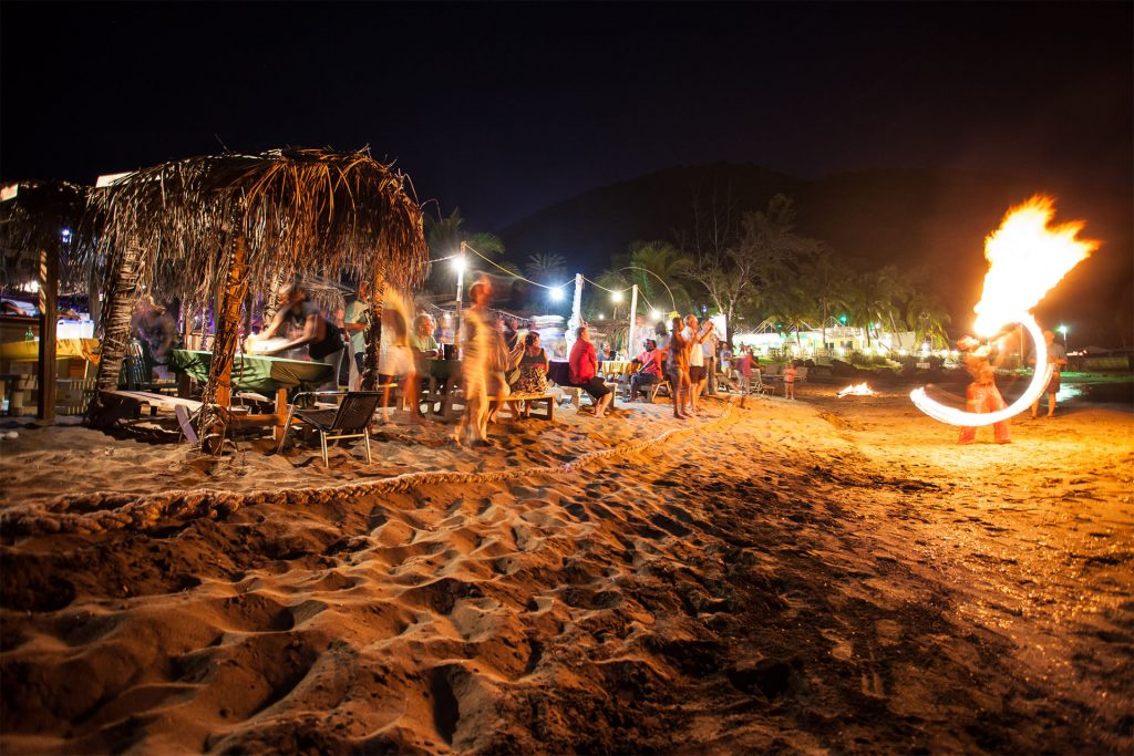 Dance the night away at a beach bar along The Strip in Frigate Bay