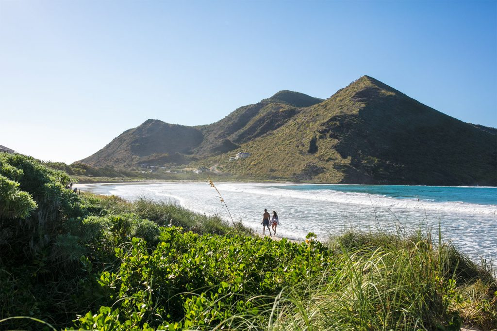 A blissful walk hand-in-hand along Sandy Bank Beach in St. Kitts